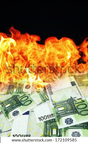 Money burns. Euro banknotes burning in flames. - stock photo
