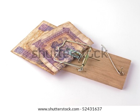 Money caught in a trap. - stock photo