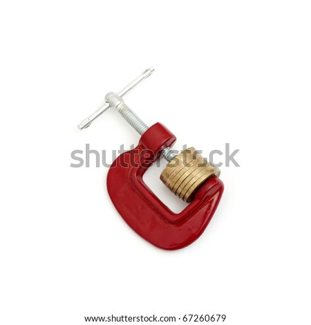 Money clamped in the clamp on a white background. (isolated) - stock photo