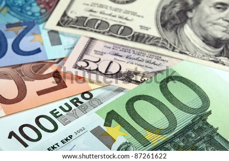 Money: close-up of euro and dollar banknotes - stock photo