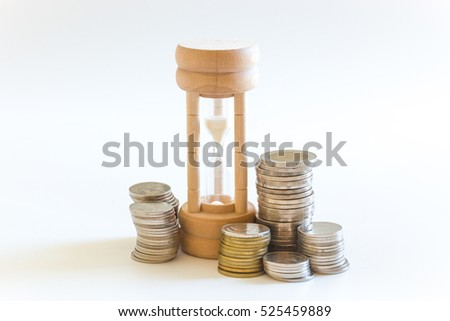 Money coin and hourglass for business earning time and finance concept