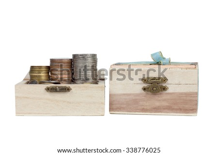 Money coin in wood case isolated on white background