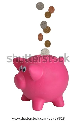 Money coins falling into a piggy bank - coins with motion blur - stock photo