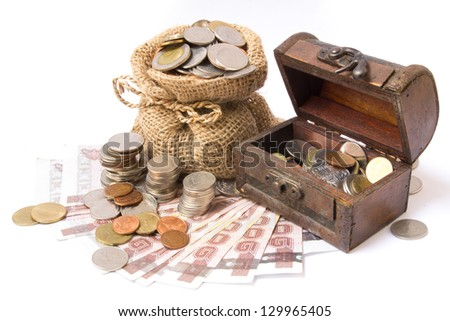 money coins in bag and wooden chest isolated on white - stock photo