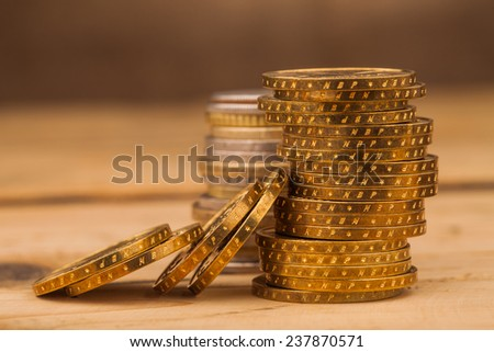 money coins pile on table - stock photo