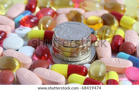 money coins surrounded by pills tablets and capsules