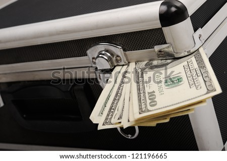 Money coming out of suitcase - stock photo