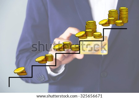 Money concept. Businessman holding credit card - stock photo