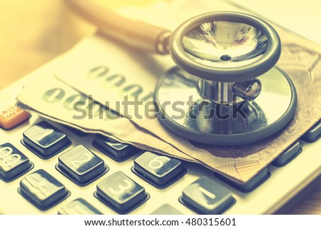 money concept : Close up Stethoscope on money calculator for Medical plans