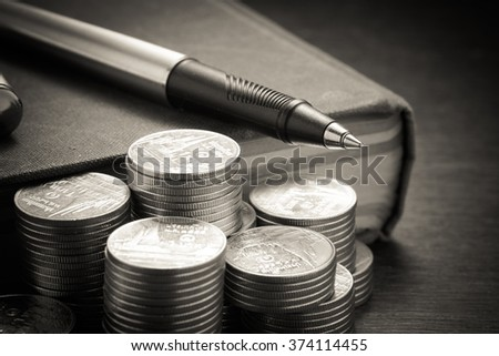 money concept coins and pen with filter effect retro vintage sty - stock photo