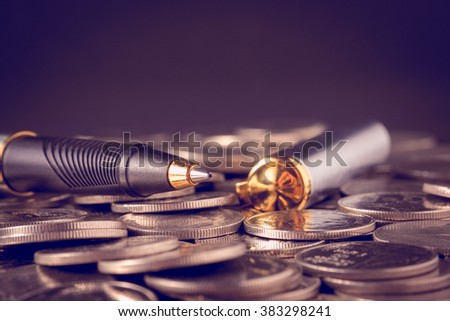 money concept coins and pen with filter effect retro vintage style