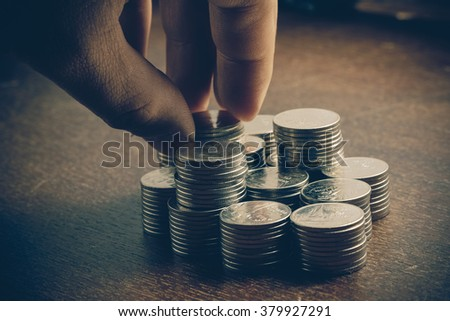 money concept coins baht thai and hand with filter effect retro vintage style - stock photo