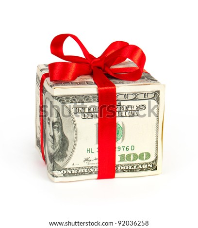 Money concept dollars in the form of a gift box isolated on white - stock photo