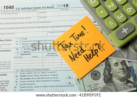 Money concept. Green calculator with cash and documents, close up - stock photo