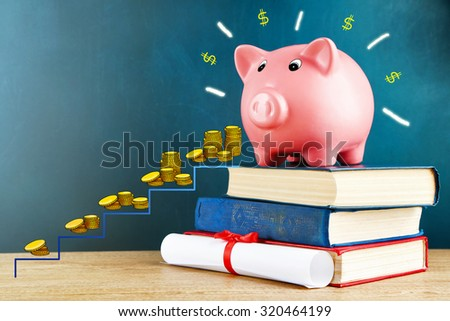 Money concept. Piggy bank with books - stock photo