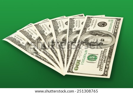 money concept - several dollars banknotes over green
