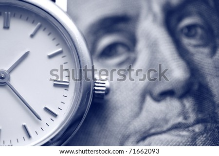 money concept: watch and portrait of Benjamin Franklin on the one hundred Dollar bill - stock photo