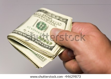 money concept with hand holding us dollars on white - stock photo