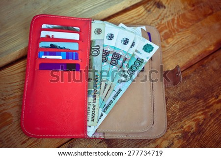 Money,credit card and purse on wooden background - stock photo
