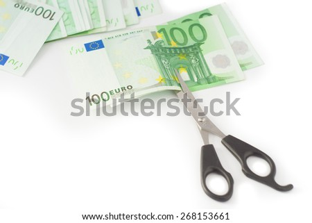 Money cutting financial savings budget  - stock photo