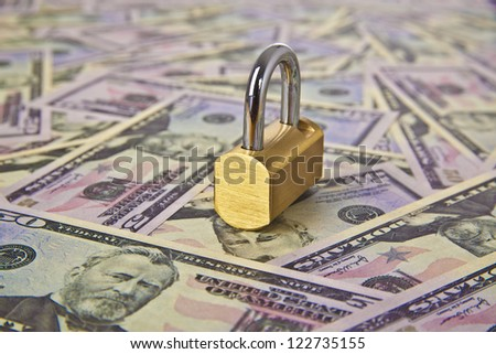 Money dollars and lock - symbol of protection of savings and money symbol bank collection, frozen accounts, insurance, trust, reliability, confidence - stock photo
