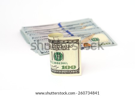 money dollars currency cash banknotes on a white background