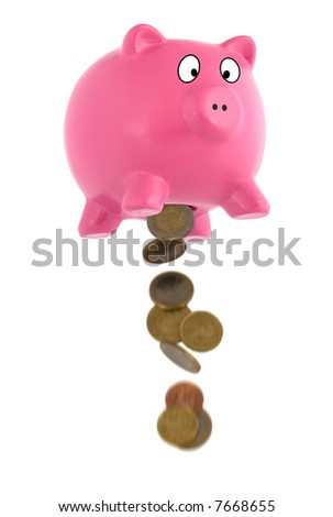 Money dropping from the piggy bank - stock photo