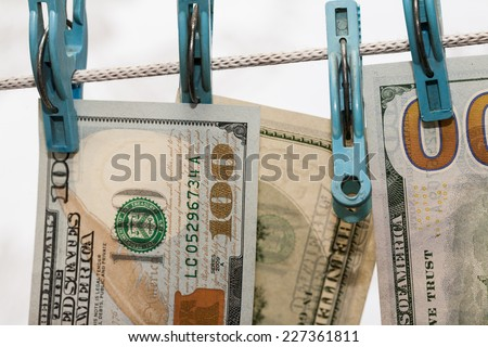 Money drying on the clothesline. The concept of money laundering - stock photo