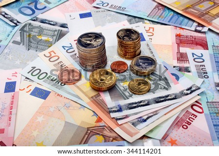 Money euro banknotes and coins - stock photo
