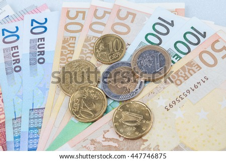 Money euro coins and banknotes in finance concept. - stock photo