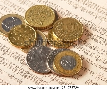 Money: euro coins and bills close up. - stock photo