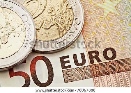 Money: euro coins and bills close up - stock photo