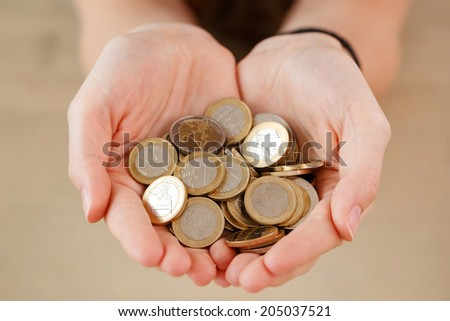 Money, euro. Woman with coins