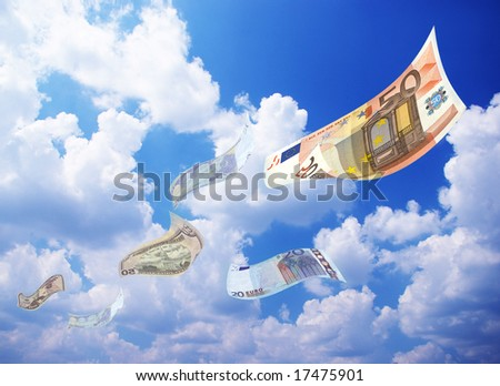 Money falling from a blue clean sky - stock photo