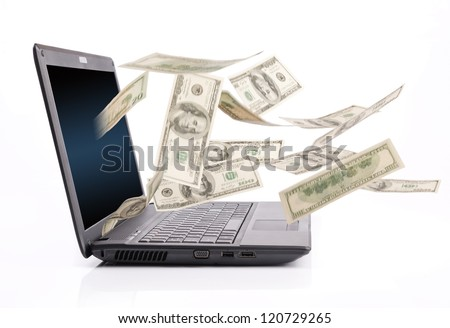 Money falling from laptop screen - stock photo