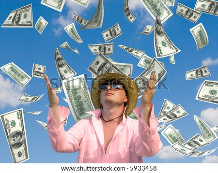 money falling in the sky and green grass background - stock photo