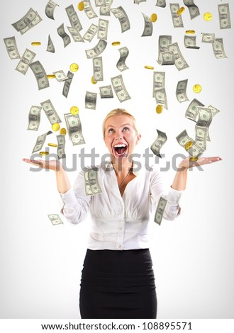 Money falling on a business woman - stock photo