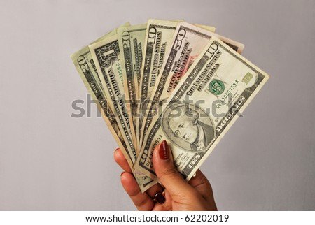 money fan in hand, close up - stock photo
