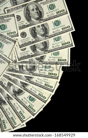 Money fan with 100 dollar bills / studio photography of american national currency of hundred dollar isolated on black background