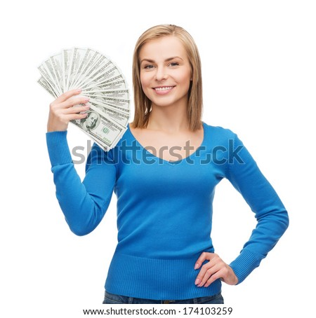 money, finances and people concept - smiling girl with dollar cash money - stock photo