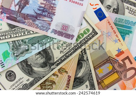 Money from different countries: dollars, euros, hryvnia, rubles - stock photo