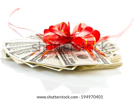 Money gift (big stack of dollars with red bow isolated on white background