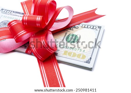 Money gift. Stack of dollars with red bow on white background