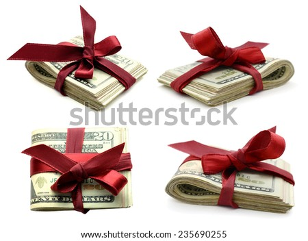 Money gifts: Dollar bunch tied up with red ribbon - stock photo