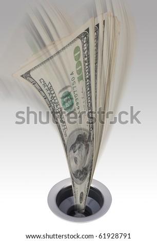 Money going down the kitchen drain. - stock photo