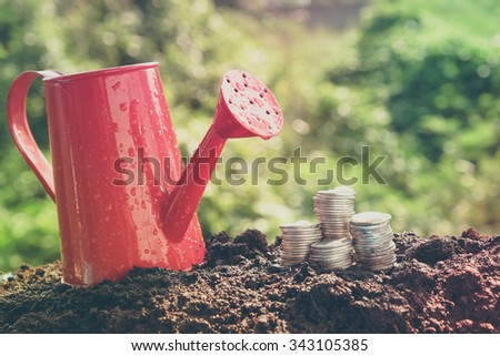 Money growth concept coins in soil with filter effect retro vintage style - stock photo
