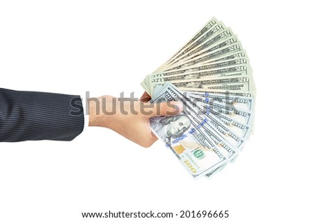 Money - hand holding banknotes - United States Dollars or USD - isolated on white