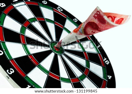 money hit the bulls-eye 100 RMB renminbi which is the cash of china chinese hit hit bullseye. The world do the bussiness and win in china.
