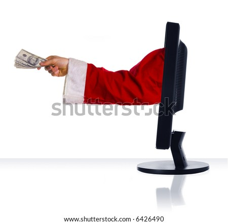 money holding from santa clause in a monitor - stock photo