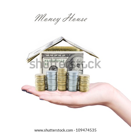 Money house on the hand isolated on white background - stock photo